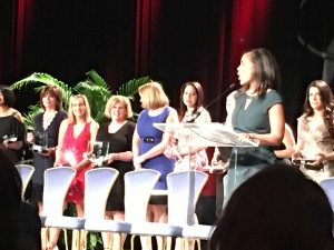 Kathy Benson accepting 50 fastest-growing women-owned/led companies award